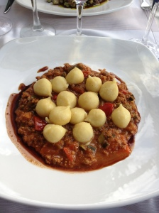 Handmade gnocchi with meat sauce