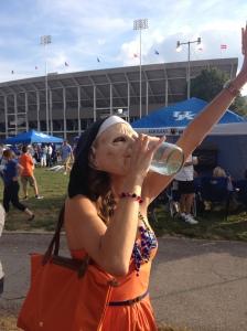 Enjoying Kentucky moonshine in a nun mask