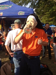 Alex enjoying Kentucky moonshine in a nun mask