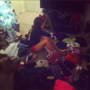 Me sitting in the middle of a pile of clothes before a ski trip