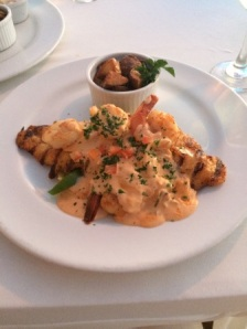 Chef's special: grouper in scallop sauce with shrimp