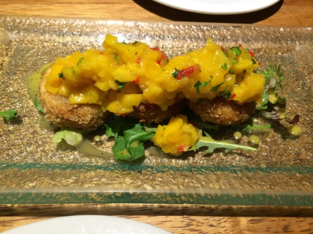 Our delicious appetizer at Greens Organic (cheese fried in quinoa with a mango cilantro salsa)