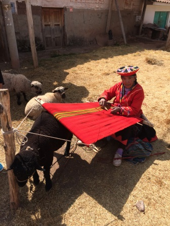 A woman weaving at the market