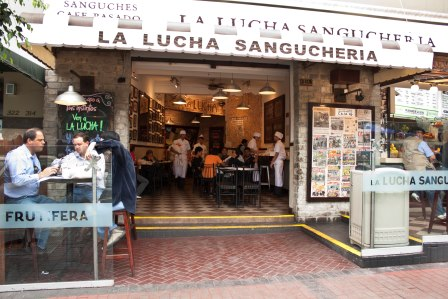 La Lucha Sangucheria. We sat right at the table shown in the left hand corner of this picture! Photo via http://mirafloresparatodos.wordpress.com/