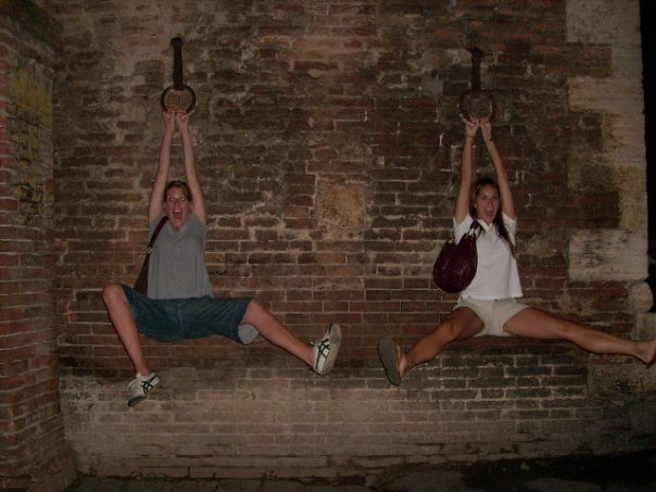 My friend Hilary and I playing at the city gate in Siena in 2008