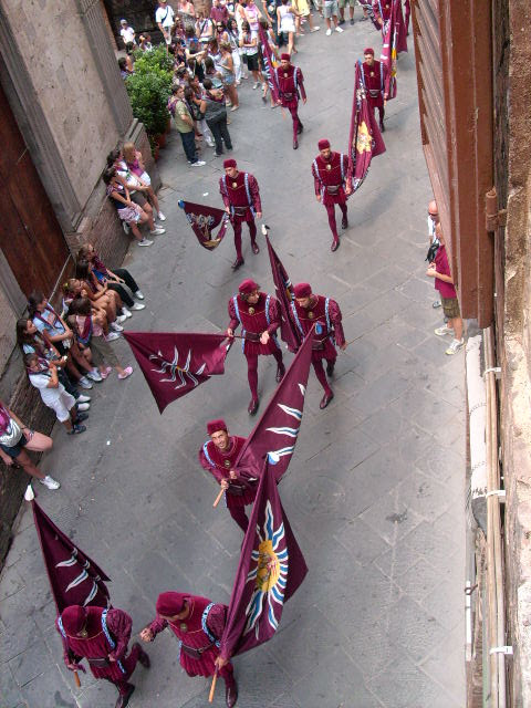 A parade as part of a contrada festival in Siena. This one is called Torre.