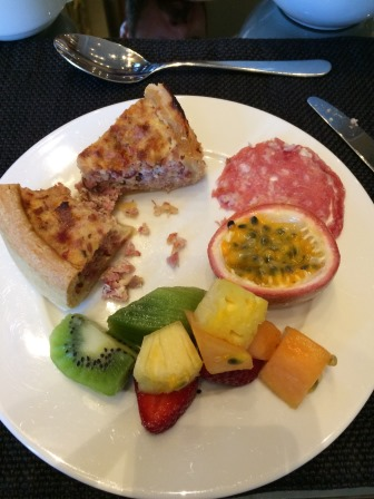 Delicious fruits and quiches at breakfast