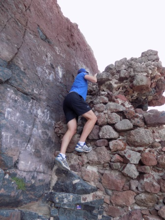 Alex scaling the rocks to reach the top of Skaros