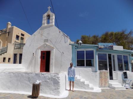 Alex outside of a church in Ano Mera