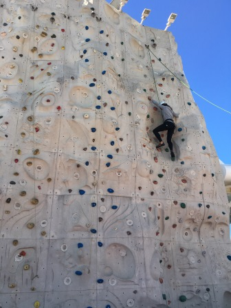 Me conquering the rock climbing wall
